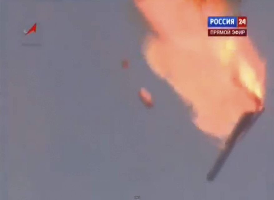 In this frame grab made from TV footage distributed by Russian Vesti 24 channel, a Russian booster rocket carrying three satellites crashes at a Russia-leased cosmodrome in Kazakhstan on Tuesday, July 2, 2013, shortly after the launch. (AP Photo/ Vesti 24 via APTN)