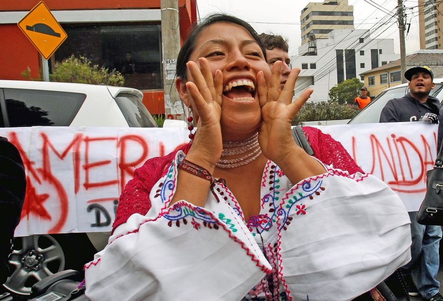 A Zuleta indigenous woman shouts support for Bolivian President Evo Morales outside the Spanish Embassy in Quito, Ecuador. Various European countries refused to let the Mr. Morales' plane cross their airspace over the Edward Snowden asylum controversy. (Associated Press)
