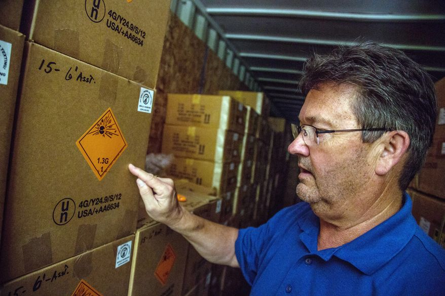 "Dominion Fireworks owner William Bulifant explains different fireworks grades. Business has ""grown leaps and bounds,"" he says. ""I do still get excited. It's very cool."" (Andrew S. Geraci/The Washington Times)"