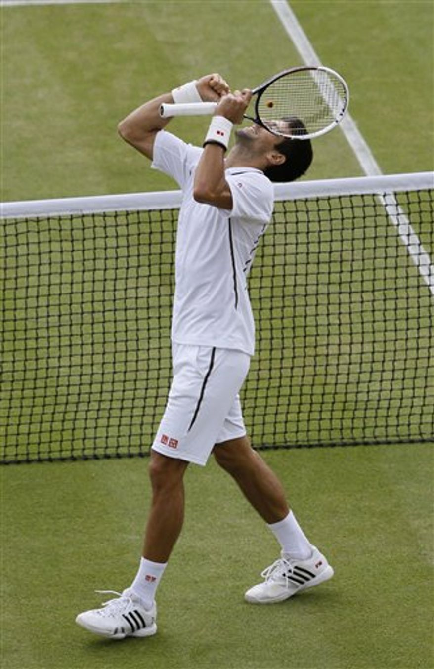 Novak Djokovic of Serbia reacts after beating Tomas Berdych of the Czech Republic in a Men's singles quarterfinal match at the All England Lawn Tennis Championships in Wimbledon, London, Wednesday, July 3, 2013. (AP Photo/Kirsty Wigglesworth)