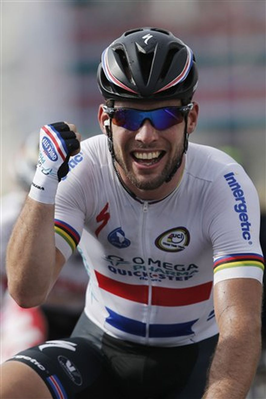 Britain's Mark Cavendish celebrates as he crosses the finish line to win the fifth stage of the Tour de France cycling race over 228.5 kilometers (142.8 miles) with start in Cagnes-sur-Mer and finish in Marseille, southern France, Wednesday July 3, 2013. (AP Photo/Christophe Ena)