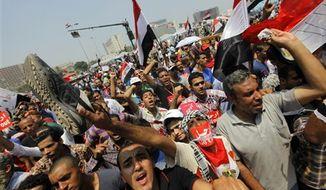 Opponents of Egypt's Islamist President Mohammed Morsi shout slogans during a protest in Tahrir Square in Cairo, Egypt, Wednesday, July 3, 2013. (AP Photo/Amr Nabil)