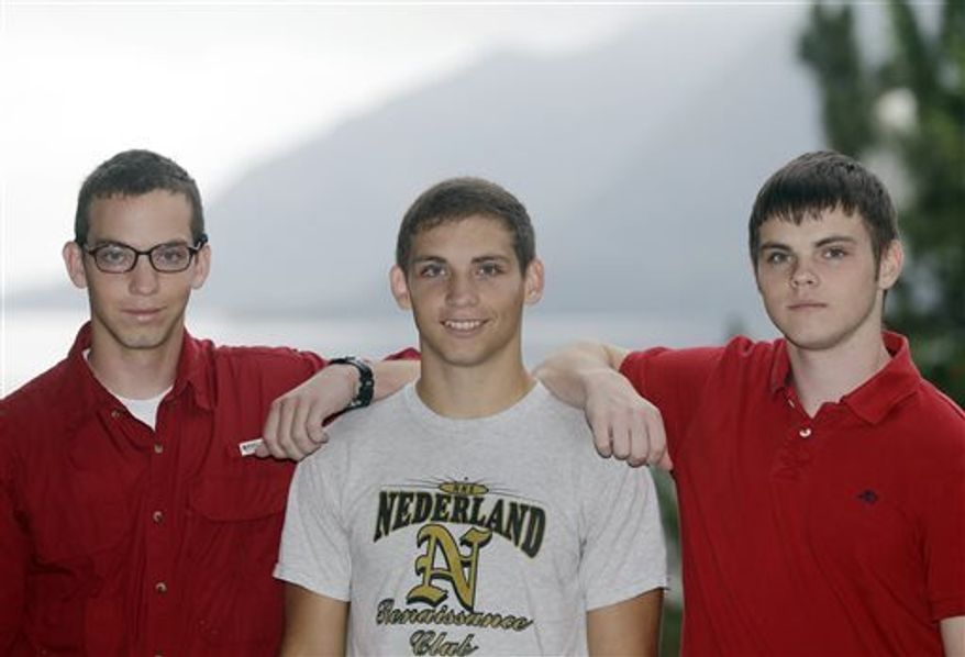 From left, brothers Noah Ogrydzniak, 19, and twins Sumner and Cole, 17, of Nederland, Texas, pose during Reception Day at the U.S. Military Academy at West Point on Monday, July 1, 2013, in West Point, N.Y. For one of the few times in its long history, the U.S. Military Academy has accepted three siblings into the same class. (AP Photo/Mike Groll)