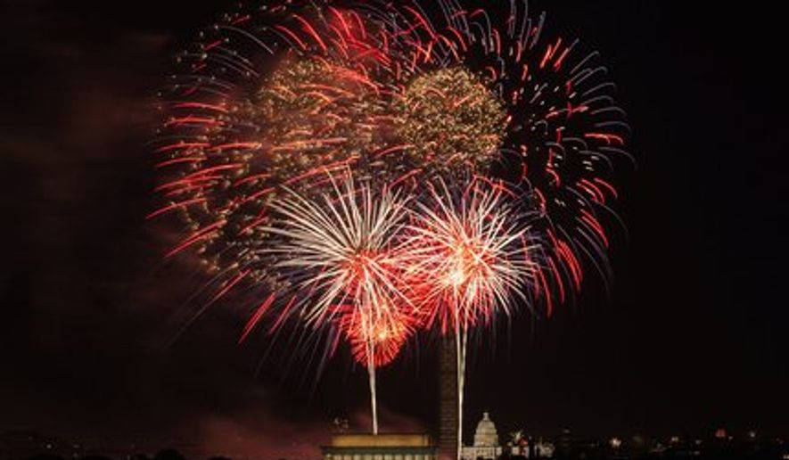 Fireworks light up the night sky on the Fourth of July as they explode in front of thousands at the U.S. Capitol, Washington Monument and Lincoln Memorial and all along the Mall in between. (Andrew S. Geraci/The Washington Times)