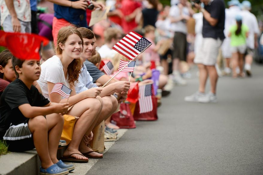 The Fourth of July parade in the Palisades section of Northwest attracted hundreds lining the streets waving flags and enjoying the national holiday. (Andrew Harnik/The Washington Times)