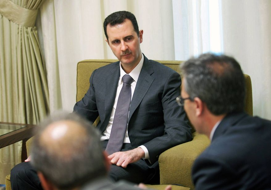 Syrian President Bashar Assad speaks during an interview with the state-run Al-Thawra newspaper in Damascus, Syria, on Thursday, July 4, 2013. (AP Photo/SANA)