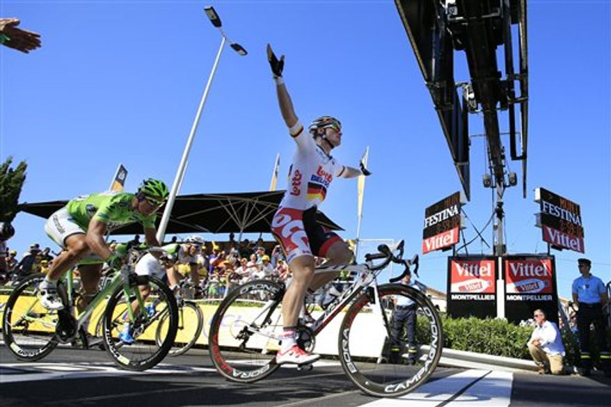 Andre Greipel of Germany celebrates crossing the finish line ahead Peter Sagan of Slovakia, second place, left, and Marcel Kittel of Germany, third place, rear in white, to win the sixth stage of the Tour de France cycling race over 176.5 kilometers (110.3 miles) with start in Aix-en-Provence and finish in Montpellier, southern France, Thursday July 4, 2013. (AP Photo/Peter Dejong)