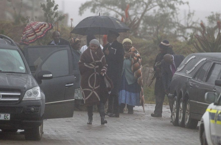 Makaziwe Mandela, center, daughter of former President Nelson Mandela walks to a car after a funeral at Nelson Mandela's house in Qunu, South Africa, Thursday, July 4, 2013. In a macabre family feud fought as Nelson Mandela remained in critical condition, a South African court ruled Wednesday that the former president's grandson must return the bodies of the 94-year-old's three deceased children to their original burial site. (AP Photo/Schalk van Zuydam)
