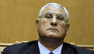 Egypt's Chief Justice Adly Mansour is sworn in as the country's interim president on Thursday. (Associated Press)