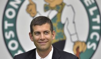 New Boston Celtics coach Brad Stevens reacts to a question during a news conference where he was introduced Friday, July 5, 2013, at the NBA basketball team's training facility in Waltham, Mass. Stevens twice led the Butler Bulldogs to the NCAA title game. He replaces Doc Rivers, who was traded to the Los Angeles Clippers. (AP Photo/Josh Reynolds)