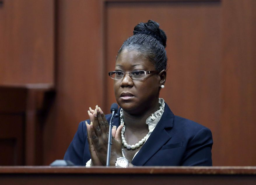 Sybrina Fulton, the mother of Trayvon Martin, takes the stand during George Zimmerman's trial in Seminole County circuit court in Sanford, Fla., on July 5, 2013. Zimmerman has been charged with second-degree murder for the 2012 shooting death of Martin. (Associated Press/Orlando Sentinel)