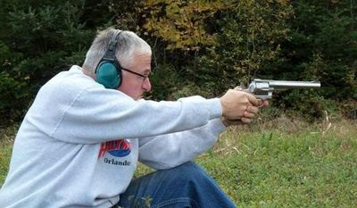 Bruce Abbott of Maine with his Ruger Redhawk .44 magnum.