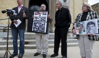 From left: Peter Isely, Arthur Budzinski, Fr. James Connell and Monica Barrett talk about the importance of the release of priest abuse files by the Archdiocese of Milwaukee on the front stairs of St. John's Cathedral in Milwaukee on June 28, 2013. (Associated Press/Milwaukee Journal Sentinel)