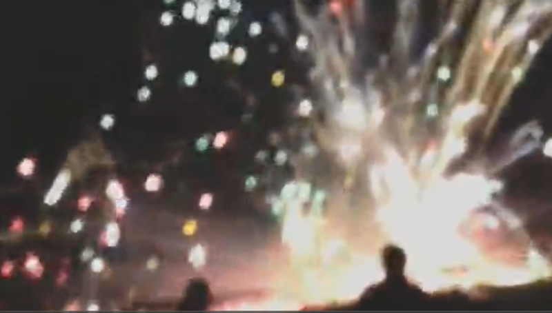 (Screen shot of an AP video depicting malfunctioning fireworks at an annual 4th of July show northwest of Los Angeles)