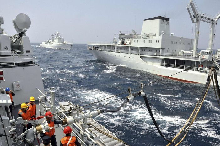 ** FILE ** In this photo taken Thursday, July 4, 2013, Chinese supply ship Hongzehu, right, refuels the Chinese missile destroyer Shenyang, left, in the Sea of Japan. China and Russia conducted their largest-ever joint naval drills in the Sea of Japan in a sign of warming ties between the former Cold War rivals. (AP Photo)