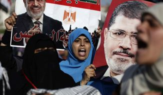 Supporters of Egypt's Islamist President Mohammed Morsi chant slogans during a rally, in Nasser City, Cairo, Egypt, Thursday, July 4, 2013. The chief justice of Egypt's Supreme Constitutional Court was sworn in Thursday as the nation's interim president, taking over hours after the military ousted Morsi. (AP Photo/Hassan Ammar)