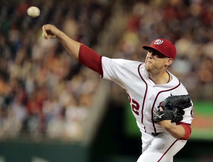 Washington Nationals relief pitcher Drew Storen (22) throws during a baseball game against the Milwaukee Brewers at Nationals Park Tuesday, July 2, 2013, in Washington. The Brewers won 4-0. (AP Photo/Alex Brandon)
