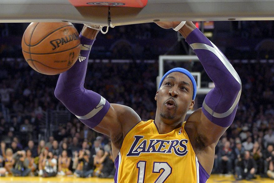FILE - In this Jan. 25, 2013, file photo, Los Angeles Lakers center Dwight Howard dunks during the first half of their NBA basketball game against the Utah Jazz, in Los Angeles.