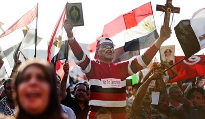 Opponents of Egypt's ousted President Mohammed Morsi rally in Cairo's Tahrir Square on Sunday while supporters of the country's first democratically elected president counter with protest demanding that he be reinstated.