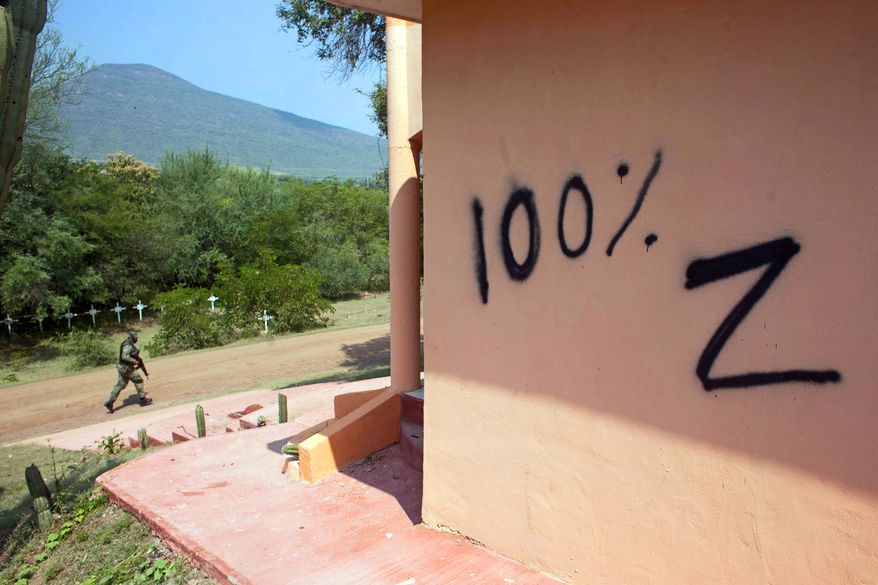 Los Zetas appears to have left a message for rival gang Caballeros Templarios, or Knights Templar, in the form of vandalism of a temple in Michoacan state, Mexico. (Associated Press)