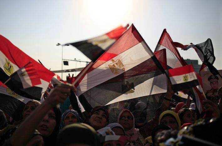 Opponents of ousted Egyptian President Mohammed Morsi rally in Tahrir Square in Cairo on Sunday, July 7, 2013. The country's new leadership wrangled over the naming of a prime minister, as both the Muslim Brotherhood and their opponents called for new mass rallies Sunday, renewing fears of another round of street violence over the military's ousting of Islamist President Mohammed Morsi. (AP Photo/Khalil Hamra)