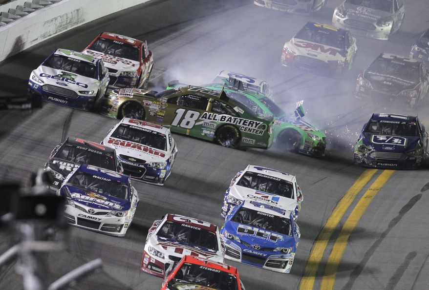 Kyle Busch (18) and Danica Patrick wreck on the last lap of the NASCAR Sprint Cup auto race at Daytona International Speedway, Saturday, July 6, 2013, in Daytona Beach, Fla. (AP Photo/David Graham)