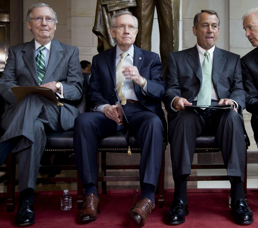 **FILE** From left: Senate Minority Leader Mitch McConnell, Kentucky Republican, Senate Majority Leader Harry Reid, Nevada Democrat, House Speaker John Boehner, Ohio Republican, and Vice President Joseph R. Biden participate in a ceremony on Capitol Hill in Washington on June 19, 2013. (Associated Press)