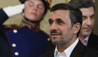 Then-Iranian President Mahmoud Ahmadinejad arrives for a meeting with Russian President Vladimir Putin in the Kremlin in Moscow, Tuesday, July 2, 2013. (AP Photo/Maxim Shemetov, Pool) ** FILE **