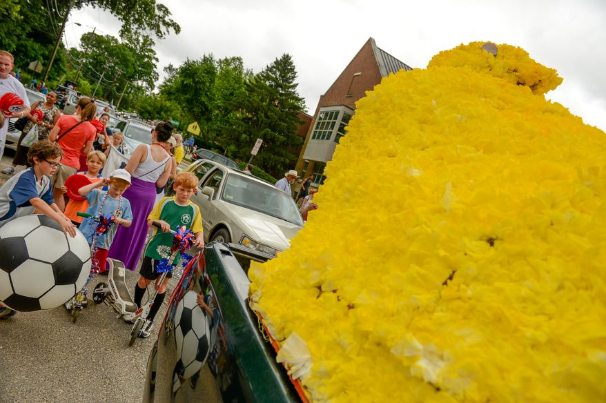 Children check out John ReVeal's Peeps float as parade vehicles get ready to leave for the Palisades July 4th Parade, Washington, D.C., Thursday, July 4, 2013. (Andrew Harnik/The Washington Times)