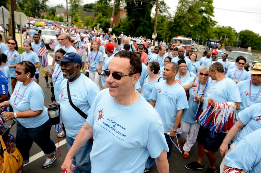 Washington, D.C. Mayor Vincent Gray, center, marches in  the Palisades July 4th Parade, Washington, D.C., Thursday, July 4, 2013. (Andrew Harnik/The Washington Times)