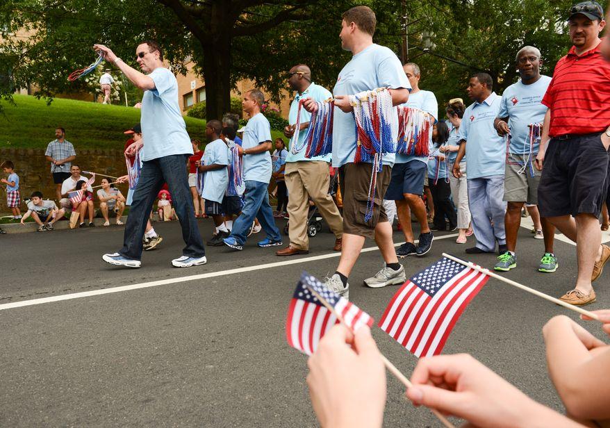 Washington, D.C. Mayor Vincent Gray, left, marches in  the Palisades July 4th Parade, Washington, D.C., Thursday, July 4, 2013. (Andrew Harnik/The Washington Times)