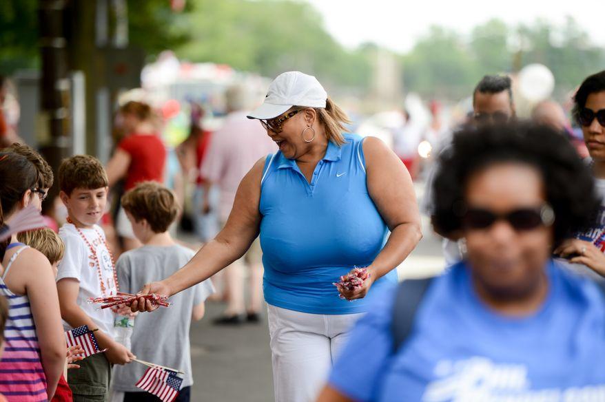 Washington, D.C. City Councilmember Yvette Alexander (Ward 7), center, walks in the Palisades July 4th Parade, Washington, D.C., Thursday, July 4, 2013. (Andrew Harnik/The Washington Times)
