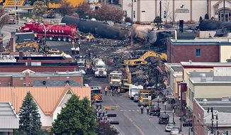 The deadly derailment of a train in Lac-Megantic, Quebec, shows the dangers of transporting oil by rail through highly populated areas. Canadian authorities said they have opened a criminal investigation. (The Canadian Press via Associated Press)