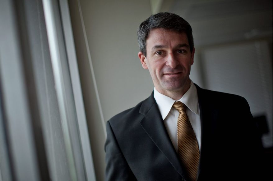 Virginia Attorney General Ken Cuccinelli stands for a portrait his office, in Richmond, Va., Tuesday, April 5, 2011. (Drew Angerer/The Washington Times)