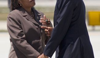 **FILE** President Obama is greeted by Rep. Marcia Fudge, Ohio Democrat, upon his arrival at Cleveland-Hopkins International Airport on June 14, 2012. (Associated Press)