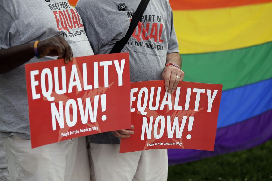 **FILE** Stevie Martin (left) and husband Arthur Martin cheer during a rally for gay marriage on June 26, 2013, on Independence Mall in Philadelphia. Despite the Supreme Court's decision, gay marriage bans still stand in Pennsylvania and roughly three dozen other states. Pennsylvania's constitution, however, does not ban gay marriage, as some other states' constitutions do. (Associated Press)