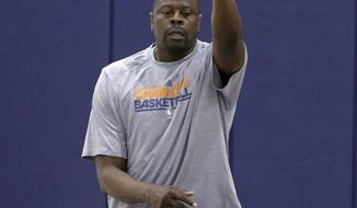 Charlotte Bobcats associate head coach Patrick Ewing tosses a ball to a player during a summer league basketball practice for the NBA team in Charlotte, N.C., Tuesday, July 9, 2013. All around him, he sees coaches being hired one right after the other. Patrick Ewing has to wonder what's going on. (AP Photo/Chuck Burton)