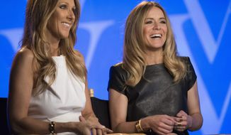 Celine Dion, left, and Veronic DiCaire speak during an interview at the Jubilee Theatre on Friday, June 28, 2013 in Las Vegas. Celine Dion is throwing her star power behind a fellow French Canadian songstress Veronic DiCaire, who is setting up shop across the street in Las Vegas. (Photo by Andrew Estey/Invision/AP)