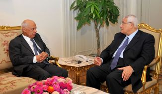 Egyptian Interim President Adly Mansour (right) meets with Hazem el-Beblawi in Cairo on Tuesday, July 9, 2013. Mr. Mansour has appointed Mr. el-Beblawi, a prominent economist, as prime minister. (AP Photo/Egyptian Presidency)