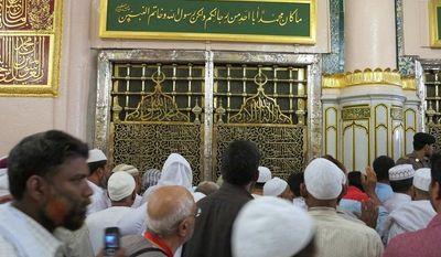 Worshippers visit the Prophet Mohammad's tomb inside the Prophet Mohammad's Mosque in Medinah city in Saudi Arabia, Saturday, July 6, 2013. (AP Photo/Hadi Mizban)
