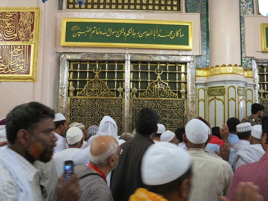 Worshippers visit the Prophet Mohammad's tomb inside the Prophet Mohammad's Mosque in Medinah city in Saudi Arabia, Saturday, July 6, 2013. (AP Photo/Hadi Mizban) ** FILE **