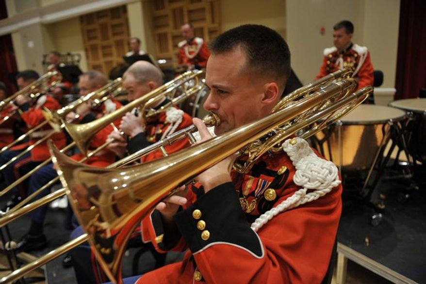 "The U.S. Marine Corps band celebrates its 215th birthday this week. It is proud of its nickname, ""The President's Own."" (United States Marine Band)"