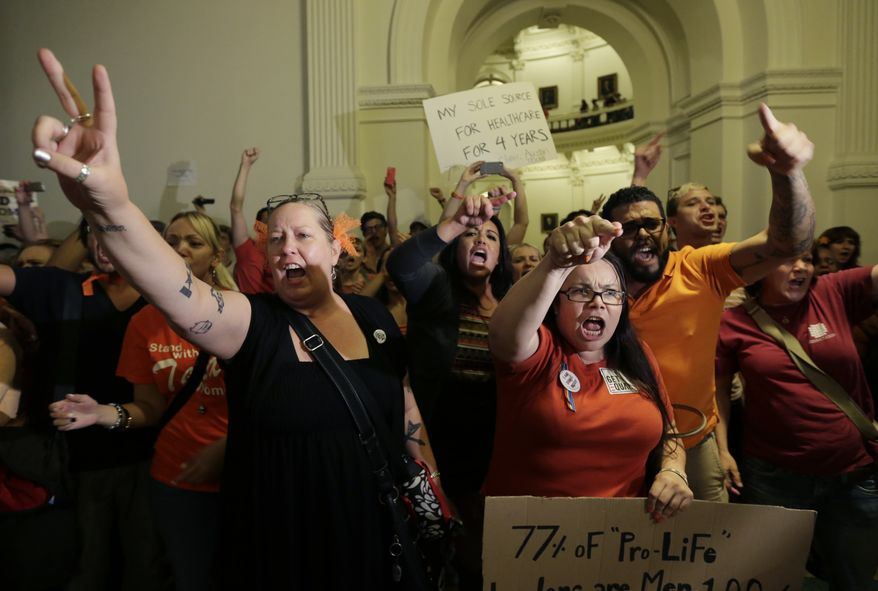 Opponents of HB 2, an abortion bill, yell outside the Texas House after the bill is provisionally approved on July 9, 2013, in Austin, Texas. The bill would require doctors to have admitting privileges at nearby hospitals, only allow abortions in surgical centers, dictate when abortion pills are taken and ban abortions after 20 weeks. (Associated Press)