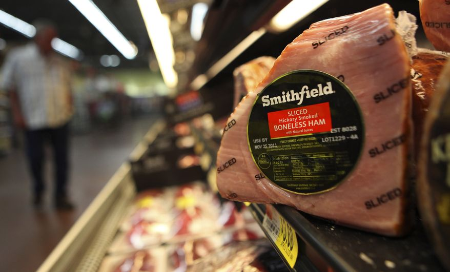 **FILE** A Smithfield ham is seen Sept. 6, 2011, at a grocery store in Richardson, Texas. (Associated Press)