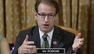 **FILE** Rep. Peter Roskam, Illinois Republican, questions ousted IRS Chief Steve Miller and J. Russell George, Treasury Inspector General for Tax Administration, on Capitol Hill, in Washington on May 17, 2013, as they testify during a hearing at the House Ways and Means Committee on the Internal Revenue Service practice of targeting applicants for tax-exempt status based on political leanings. (Associated Press)