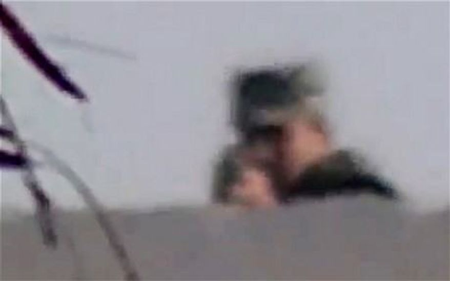 Egyptian newspaper photographer Ahmed Samir Assem captured his own death on film, July 9, 2013. An Egyptian solider is seen turning his rifle towards the camera and firing a moment before the screen goes black. (Screen shot Telegraph video)