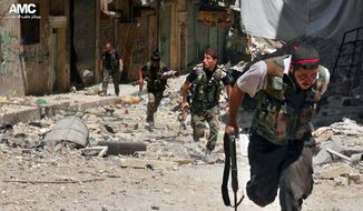 This Tuesday, July 9, 2013, citizen journalism image provided by Aleppo Media Center AMC, which has been authenticated based on its contents and other AP reporting, shows Syrian rebels running during heavy clashes with Syrian soldiers loyal to Syrian President Bashar Assad, in the Salah al-Din neighborhood of Aleppo, Syria. (AP Photo/Aleppo Media Center AMC)