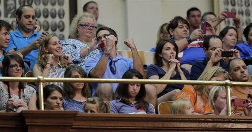 Supporters of HB 2, an abortion bill, react in the gallery of the Texas House after the bill was provisionally approved, Tuesday, July 9, 2013, in Austin, Texas. (Associated Press)