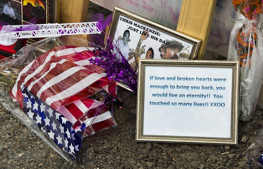 Items are displayed at a makeshift memorial at the Fire Station No. 7 memorial for fallen firefighters Saturday, July 6, 2013, in Prescott, Ariz. Nineteen Granite Mountain Hotshot firefighters were killed by an out-of-control blaze near Yarnell, Ariz., on June 30. (AP Photo/The Arizona Republic, Tom Tingle)