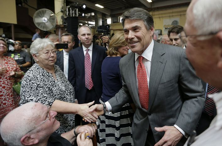 **FILE** Texas Gov. Rick Perry greets supporters July 8, 2013, as he leaves Holt Cat in San Antonio after announcing he will not seek re-election. A staunch Christian conservative, proven job-creator and fierce defender of states' rights, Perry has been in office nearly 13 years, making him the nation's longest-sitting current governor. (Associated Press)